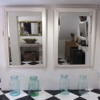 Pair of neoclassical mirrors