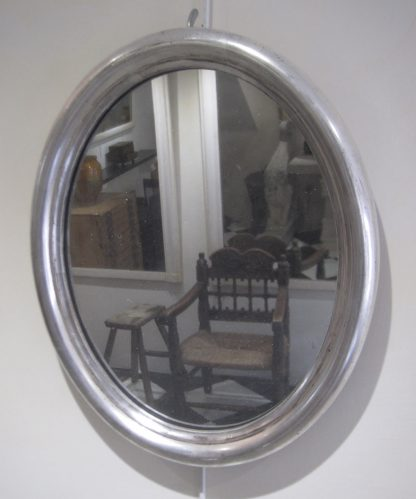 Pair of silver oval mirrors