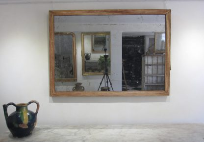 Neoclassical reeded mirror